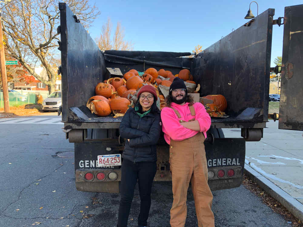 Helpers in front of pumpkin recycling truck
