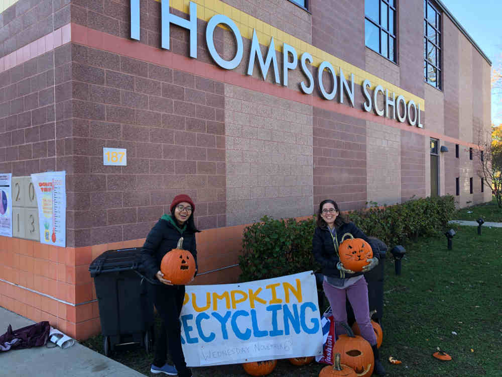 Helpers in front of Thompson school during pumpkin recycling